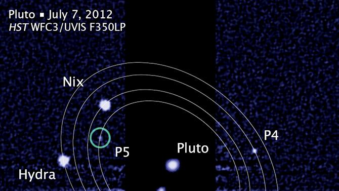 "FILE -This file  photo provided and annotated by NASA/Hubble Space Telescope shows the five moons in their orbits around Pluto. An online vote to name Pluto's two newest, itty-bitty moon concluded Monday, Feb. 25, 2013, and the winner is Vulcan, a name suggested by actor William Shatner, who played Capt. Kirk in the original ""Star Trek"" TV series. (AP Photo/NASA/Hubble Space Telescope)"
