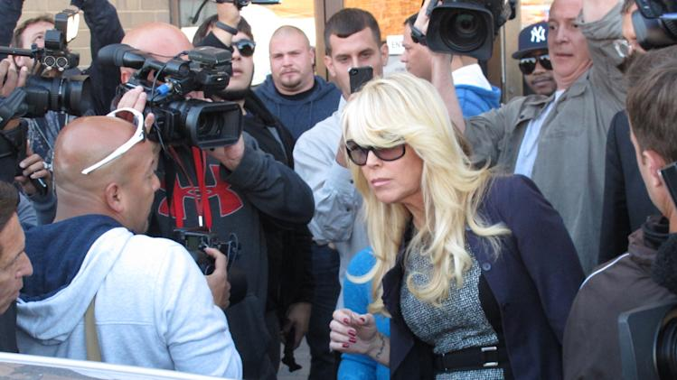FILE - Dina Lohan leaves court in Hempstead, N.Y. in this Sept. 24, 2013 file photo after pleading not guilty to drunken driving charges. A judge on Thursday Nov. 21, 2013 referred Lindsay Lohan's mother to a community service program, saying volunteering could help her alleged drunken-driving case. (AP Photo/Frank Eltman, File)