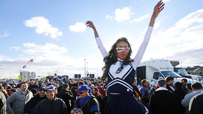 "A woman dances during an event called ""The Tailgate with Cause"" to raise money for people suffering from the affects of Superstorm Sandy and cystic fibrosis as fans tailgate before an NFL football game between the New York Giants and the Pittsburgh Steelers, Sunday, Nov. 4, 2012, in East Rutherford, N.J. (AP Photo/Julio Cortez)"