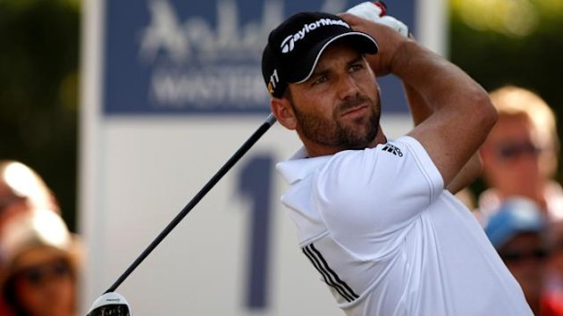 Sergio Garcia of Spain tees off on the first hole during the final round of the Andalucia Valderrama Masters golf tournament in Sotogrande, southern Spain, October 30, 2011 (Reuters)