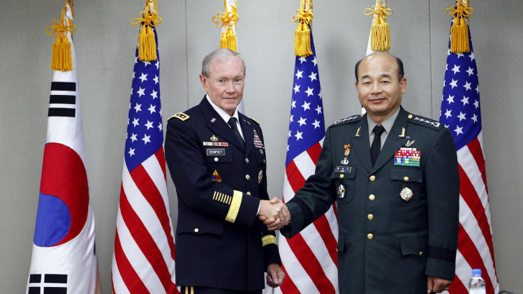 FILE - In this Thursday, Oct. 27, 2011 file photo, South Korean Joint Chiefs of Staff Chairman Gen. Jung Seung-jo, right, shakes hands with his U.S. counterpart, Gen. Martin Dempsey before their Military Committee Meeting between the U.S. and South Korea at Defense Ministry in Seoul, South Korea. South Korean Joint Chiefs of Staff Chairman Gen. Jung Seung-jo had planned to meet with his U.S. counterpart, Gen. Martin Dempsey, in Washington on April 16 for regular talks. But tensions on the Korean Peninsula are so high that Jung cannot take a long trip away from South Korea, so the meeting will be rescheduled, a South Korean Joint Chiefs officer said Sunday. (AP Photo/ Lee Jin-man, Pool, File)