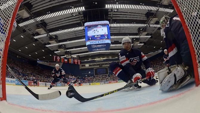 Jones of the US defends next to goaltender Campbell during their Ice Hockey World Championship game against Russia at the CEZ arena in Ostrava