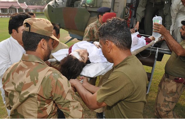 In this photo released by Inter Services Public Relations department, Pakistani soldiers carry wounded Pakistani girl, Malala Yousufzai, from a military helicopter to a military hospital in Peshawar, 