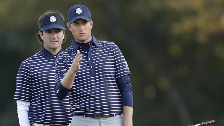USA's Bubba Watson, left, and Webb Simpson look over a putt on the fifth hole during a foursomes match at the Ryder Cup PGA golf tournament Saturday, Sept. 29, 2012, at the Medinah Country Club in Medinah, Ill. (AP Photo/David J. Phillip)
