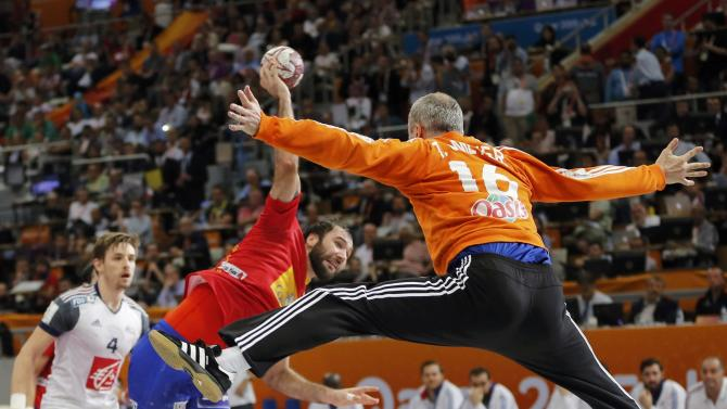 Goalkeeper Omeyer of France saves a shot of Canellas of Spain during their semi-final match of the 24th Men's Handball World Championship in Doha