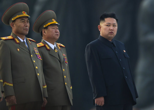 In this April 13, 2012 photo, North Korean leader Kim Jong Un stands next to senior military leaders during a ceremony in honor of his father, Kim Jong Il and grandfather, Kim Il Sung in Pyongyang. In very different ways, North Korea, run by the same family as a Stalinist dictatorship since the 1940s, and Myanmar, run by a cabal of generals, have opened themselves up over the past year or so, allowing the world to peer behind the political curtains they had so laboriously erected, but the question of whether there has been any real change still remains. (AP Photo/David Guttenfelder)