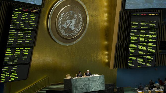 Two electronic boards show the results of a vote in the United Nations General Assembly, Wednesday May 15, 2013. The U.N. General Assembly approved an Arab-backed resolution calling for a political transition in Syria and strongly condemning President Bashar Assad's regime for its escalating use of heavy weapons. The resolution, which is not legally binding, was adopted by a vote of 107-12 with 59 abstentions. (AP Photo/Evan Schneider, United Nations)