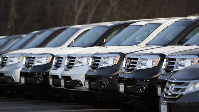 In this Wednesday, Dec. 5, 2012, photo, Honda Pilots are seen outside of a Honda car dealership in Des Plaines, Ill. The U.S. auto industry ended 2012 on a high note, with December sales the strongest they have been since before the recession. Analysts predict an even bigger year in 2013, as a stronger economy, low-interest rates, aging cars on the road and competitive new products continue to draw buyers to dealerships.  (AP Photo/Nam Y. Huh)