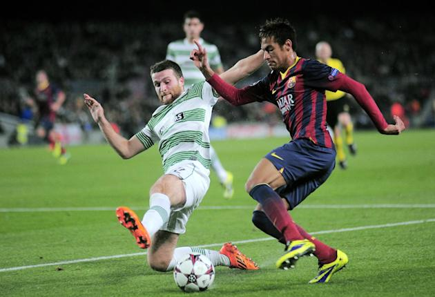 FC Barcelona's Neymar, from Brazil, right, battles for the ball against Celtic's Adam Matthews during a Champions League Group H soccer match at the Camp Nou in Barcelona, Spain, Wednesday, De