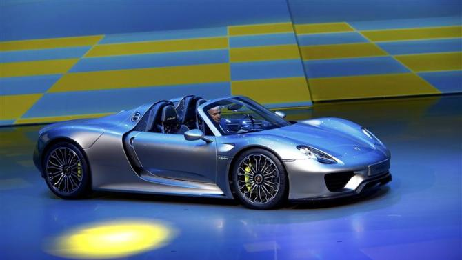 Porsche CEO, Matthias Mueller presents the new Porsche 918 Spyder hybrid car at the Volkswagen group night at the Frankfurt motor show