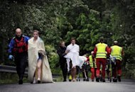 "Rescue workers evacuate young people from Utoeya island after Anders Behring Breivik's attack last July. Breivik insists that the victims of his shooting spree on Utoeya island, where he killed 69 people -- mainly teens attending a Labour Party youth summer camp -- were ""not innocent children, but political activists."""