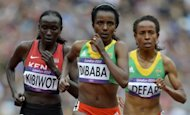 (From left) Kenya's Viola Kibiwot, Ethiopia's Tirunesh Dibaba Kenene and Ethiopia's Meseret Defar compete in the women's 5000m heats at the athletics event during the London 2012 Olympic Games. Dibaba qualified fastest for the final of the 5000m on Tuesday as she chases a second consecutive Olympic long distance double