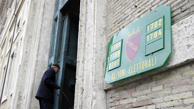 A man arrives to vote in a polling station in downtown Rome, Sunday, Feb. 24, 2013. Italy votes in a watershed parliamentary election Sunday and Monday that could shape the future of one of Europe's biggest economies. (AP Photo/Andrew Medichini)