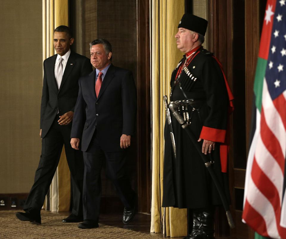 President Barack Obama and Jordan's King Abdullah II arrive for their joint new conference at the King's Palace in Amman, Jordan Friday, March 22, 2013. (AP Photo/Pablo Martinez Monsivais)