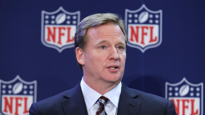 """NFL Commissioner Roger Goodell listens to a question during a news conference after the NFL owners meeting, Wednesday, Dec. 12, 2012, in Irving, Texas. Goodell said he """"fundamentally disagrees"""" with former league boss Paul Tagliabue's decision not to discipline players in the New Orleans Saints bounty scandal. (AP Photo/LM Otero)"""