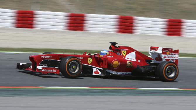 Ferrari driver Fernando Alonso of Spain steers his car during the Formula One Spanish Grand Prix, at the Catalunya racetrack in Montmelo, near Barcelona, Spain, Sunday, May 12, 2013. (AP Photo/Luca Bruno)