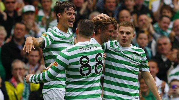 Celtic&#39;s Lustig celebrates with his team mates after scoring against Hibernian