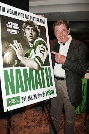 """In this photo provided by StarPix, former New York Jets' quarterback Joe Namath stands next to a poster bearing his image at the New York premiere of """"Namath,"""" Wednesday, Jan. 25, 2012. (AP Photo/StarPix, Dave Allocca)"""
