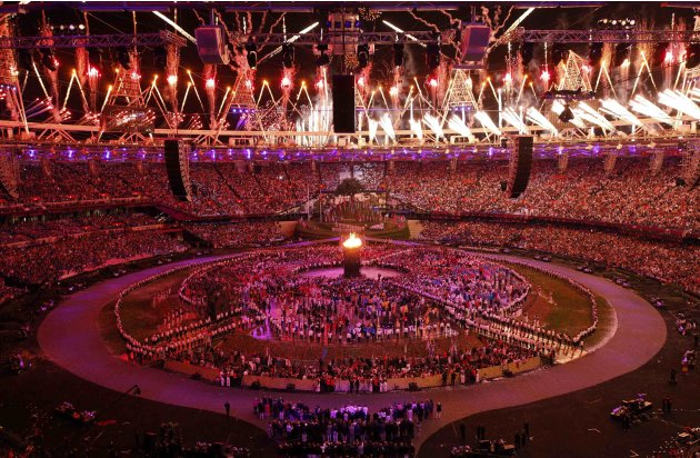 Fireworks explode over the Olympic Stadium after the Olympic Flame was lit during the opening ceremony of the London 2012 Olympic Games
