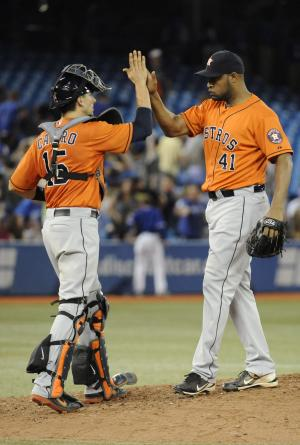 Houston Astros Jason Castro, left, and pitcher Jose Veras celebrate after their 8-6 win over the Toronto Blue Jays in a baseball Saturday, July 27, 2013, in Toronto. (AP Photo/The Canadian Press, Jon Blacker)