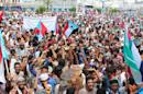 Supporters of the southern separatist movement wave the movements flag during a rally in Yemen's second city of Aden on April 18, 2016