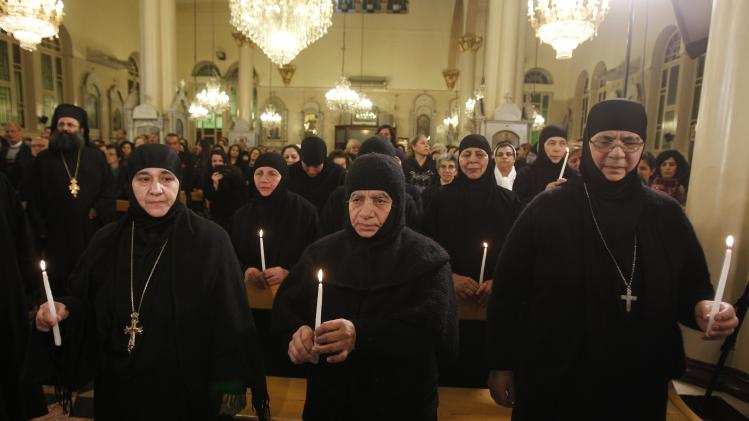 Head of Mar Thecla monastery in Maloula Mother Plagia Sayyaf, who was freed with others after being held by rebels for over three months, attends with nuns a prayer of thanks after their release at the Holy Cross Church