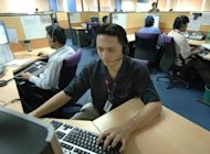 This file photo shows Filipino call center emplyees working in suburban Manila, on August 25, 2005. The peso's rise is hitting call centres in the Philippines, handicapping the global leader in the lucrative business as it combats a challenge from top rival India, industry officials said on Wednesday