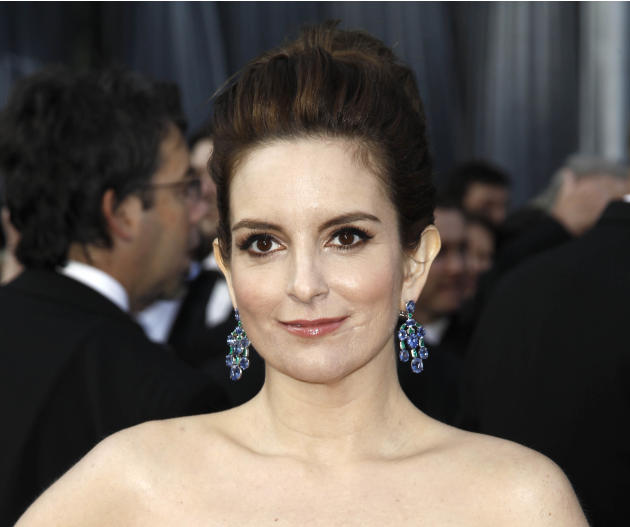 FILE - This Feb. 26, 2012 file photo shows Tina Fey arriving at the 84th Academy Awards in the Hollywood section of Los Angeles. On Tuesday night, Fey received Audie Awards for Audio Book of the Year