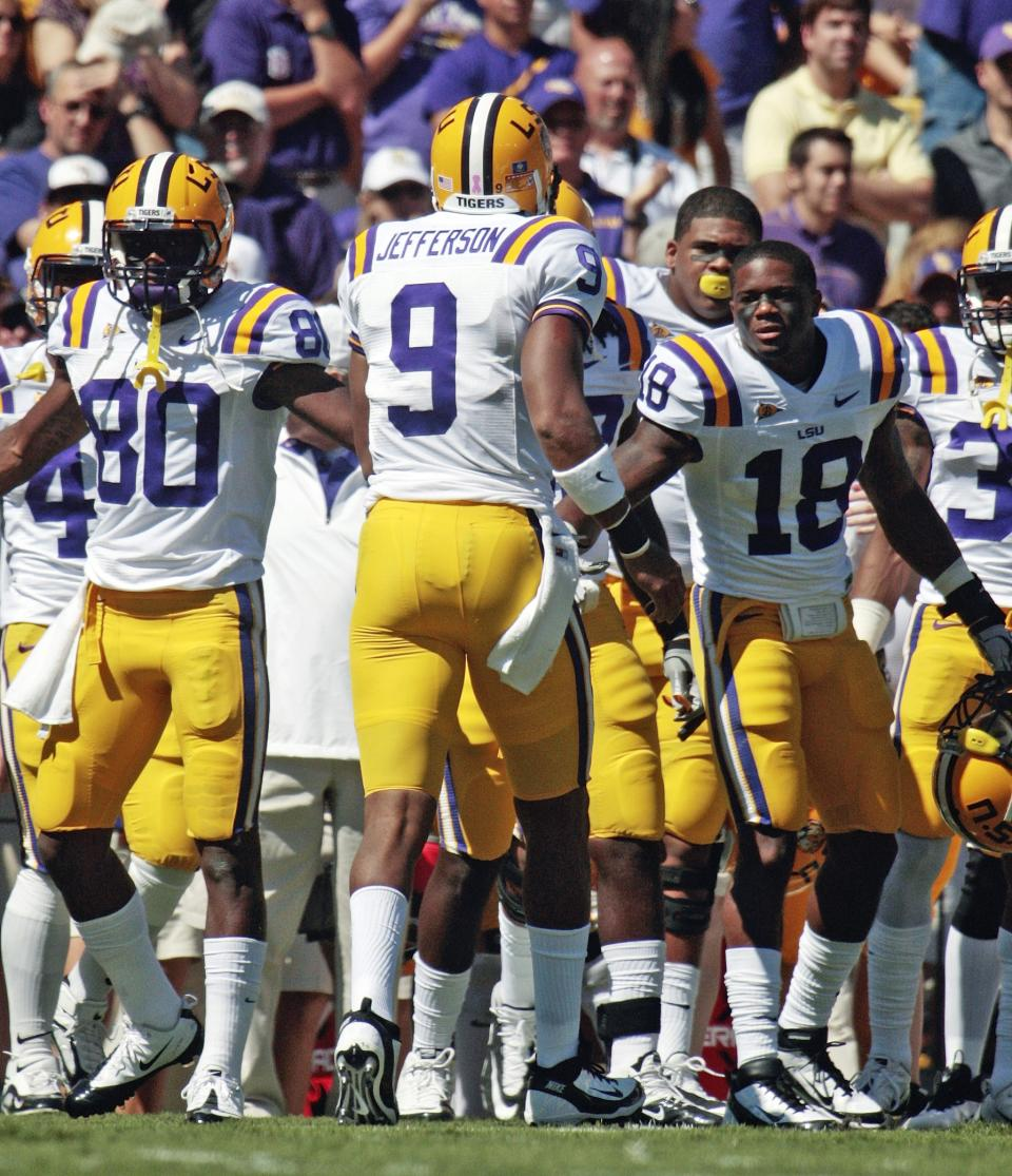 LSU quarterback Jordan Jefferson (9) is congratulated by Brandon Taylor (18) after scoring a touchdown against Kentucky in the first quarter of an NCAA college football game in Baton Rouge,  La., Saturday, Oct. 1, 2011. (AP Photo/Bill Haber)