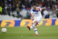 Lyon&#39;s French midfielder Clement Grenier scores a goal during their French L1 football match against Valenciennes at the Gerland Stadium in Lyon. Olympique Lyonnais kept their unbeaten start to the new Ligue 1 campaign going as they came from behind to record a 3-2 home win against Valenciennes