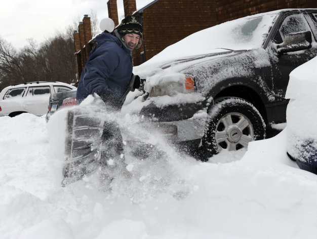 <p>               Richard Effinger, 43, digs his truck out from the snow Saturday morning, Feb. 9, 2013 in Danbury, Conn. A behemoth storm packing hurricane-force wind gusts and blizzard conditions swept through the Northeast overnight. (AP Photo/The News-Times, Carol Kaliff) MANDATORY CREDIT: THE NEWS-TIMES, CAROL KALIFF