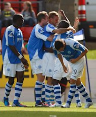 St Johnstone's players celebrate after Rowan Vine scores the winning goal against Celtic