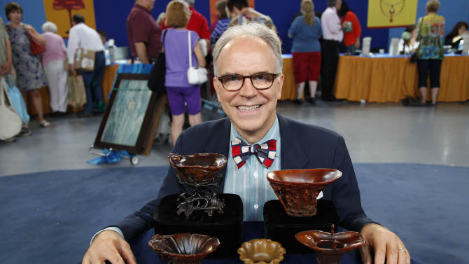 "In this Saturday, July 23, 2011 photo, Asian art expert and veteran ""Antiques Roadshow."" appraiser Lark Mason poses with a collection of Chinese rhinoceros horned cups  in Tulsa, Okla. PBS says the collection was judged by Mason to be worth $1 million to $1.5 million, the most valuable item brought in for appraisal in the history of ""Antiques Roadshow,"" which will air its 16th season next year. (AP Photo/WGBH)"