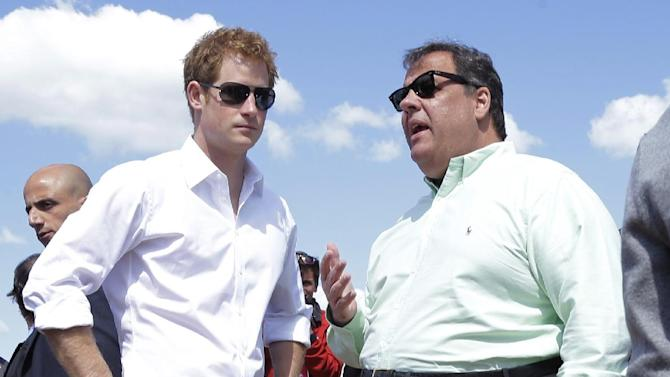 New Jersey Gov. Chris Christie, right, talks to Britain's Prince Harry while visiting the area hit by Superstorm Sandy, Tuesday, May 14, 2013, in Seaside Heights, N.J.  Prince Harry began a tour  of New Jersey's storm-damaged coastline, inspecting dune construction, walking past destroyed homes and shaking hands with police and other emergency workers.  New Jersey sustained about $37 billion worth of damage from the storm. (AP Photo/Mel Evans, Pool)