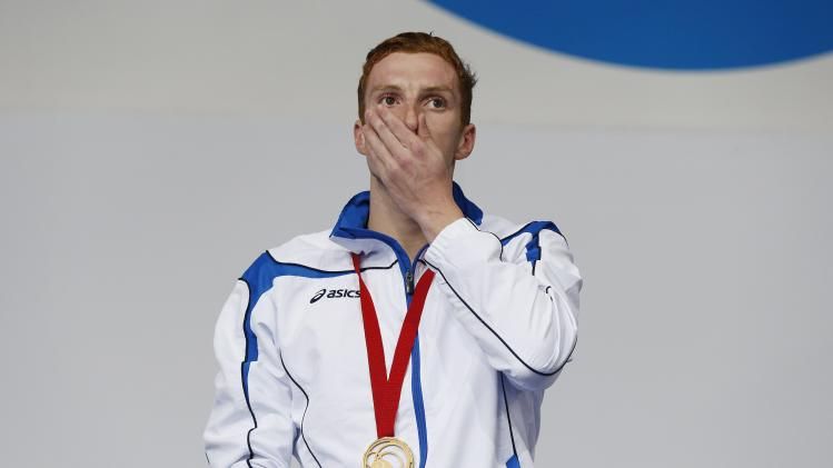 Scotland's gold medallist Wallace reacts during the ceremony for the Men's 400m Individual Medley Final at the 2014 Commonwealth Games in Glasgow, Scotland