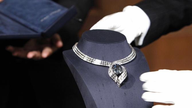 """The Hope Diamond is seen in its new temporary setting, """"Embracing Hope,"""" Thursday, Nov. 18, 2010, at the Smithsonian National Museum of Natural History in Washington. The temporary setting is platinum with 340 baguette diamonds and took more than eight months to create. (AP Photo/Ann Heisenfelt)"""