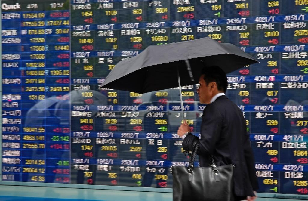 Asia markets end week on low after Wall St losses
