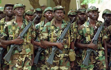 Senegalese troops, being trained for the African Crisis Response Initiative, stand at attention with..