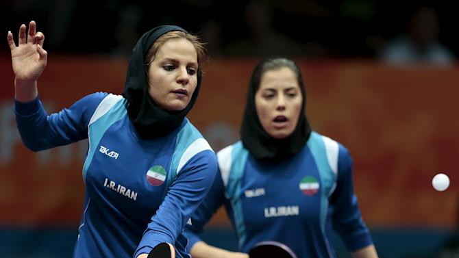 Iran's Mahjobeh Omrani and Neda Shahsavari play against Singapore's Tianwei Feng and Mengyu Yu in their women's doubles first round match at the World Table Tennis Championships in Suzhou