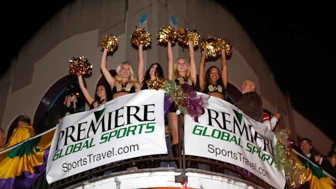 IMAGE DISTRIBUTED FOR PREMIERE GLOBAL SPORTS - The New Orleans Saints cheerleaders can be seen at the Premiere Global Sports Balcony Over Bourbon Party in New Orleans, Louisiana on Friday, Feb. 1, 2013. (Scott Boehm /AP Images for Premiere Global Sports)