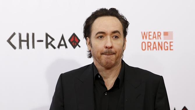 "Actor John Cusack poses on the red carpet at the premiere of ""Chi-Raq"" in New York"