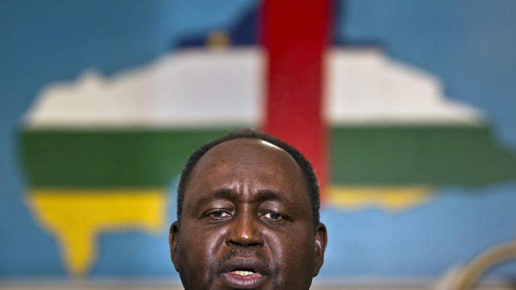 President of the Central African Republic Francois Bozize speaks to the media, in front of a map of the country with the colors of its flag, at the presidential palace in Bangui, Central African Republic Tuesday, Jan. 8, 2013. (AP Photo/Ben Curtis)