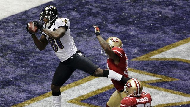 FILE - In this Feb. 3, 2013, file photo, Baltimore Ravens wide receiver Anquan Boldin (81) catches a 13-yard pass for a touchdown as San Francisco 49ers linebacker NaVorro Bowman (53) trails the play during the first half of the NFL Super Bowl XLVII football game in New Orleans. The Ravens announced on Monday, March 11, that the 49ers have acquired Boldin for a sixth-round draft pick. (AP Photo/Charlie Riedel, File)