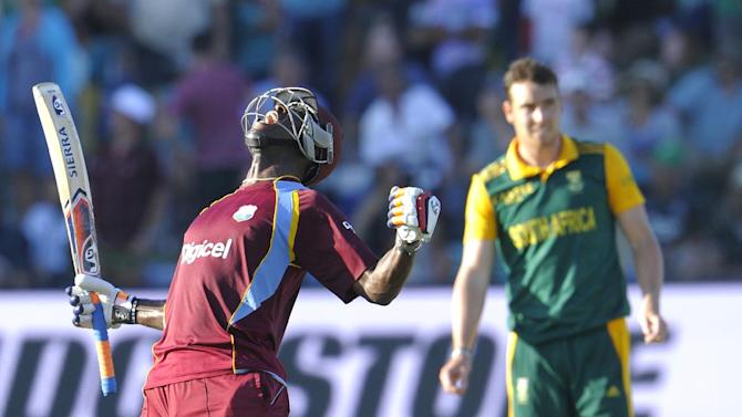 West Indies batsman Andre Russell (L) celebrates after they beat South Africa by one wicket during the fourth one-day international at St. George's Park in Port Elizabeth on January 25, 2015