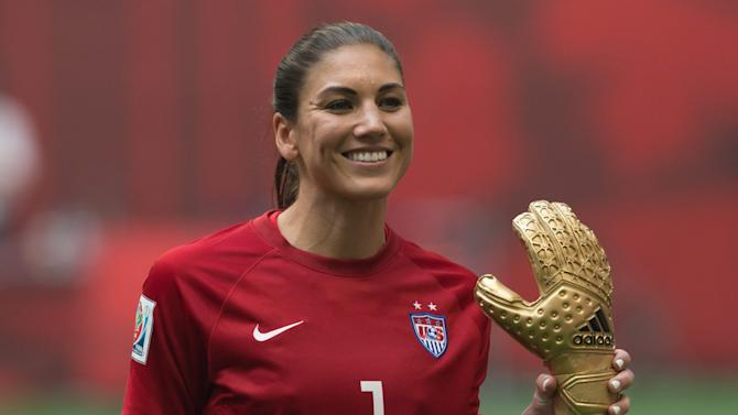 United States goalkeeper Hope Solo holds her Golden Glove award which was presented after the United States defeated Japan to win the Women's World Cup soccer championship in Vancouver, British Columbia, Canada, Sunday, July 5, 2015.   (Darryl Dyck/The Canadian Press via AP) MANDATORY CREDIT