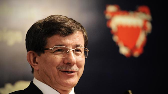 Turkish Foreign Minister Ahmet Davutoglu speaks during a joint press conference with his Bahraini counterpart Sheikh Khaled bin Ahmed al-Khalifa (unseen) in Manama on November 24, 2013