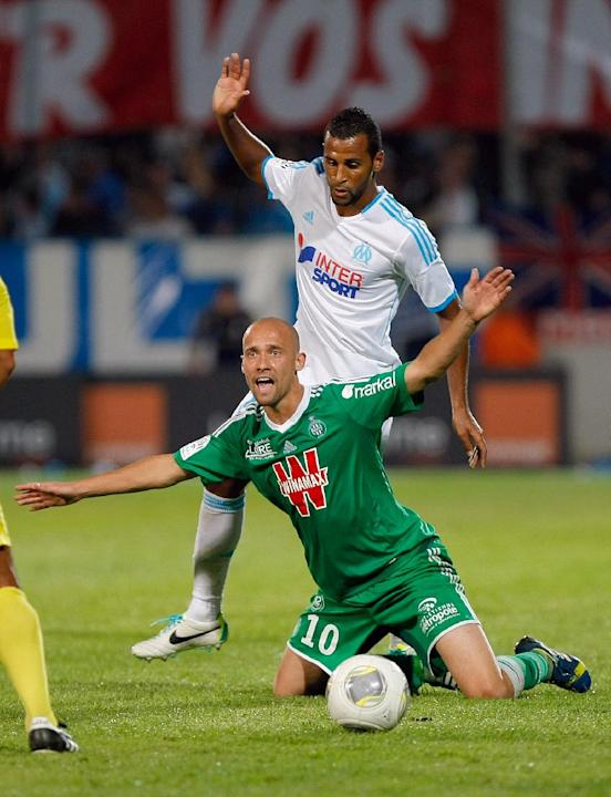 Saint-Etienne's French midfielder Renaud Cohade, front, and Marseille's Togolese midfielder Jacques-Alaixys Romao battle for the ball during their League One soccer match, at the Velodrome Stadium, in