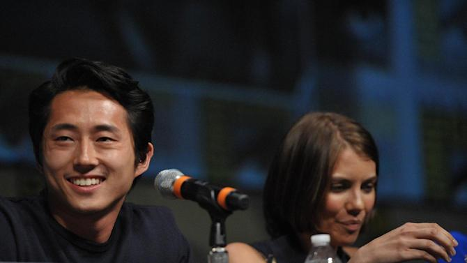 "COMMERCIAL IMAGE -  Steven Yeun and Lauren Cohan at AMC's ""The Walking Dead"" Autograph Signing and Panel on Friday July 13, 2012, in San Diego. (Photo by John Shearer/Invision for AMC/AP Images)"
