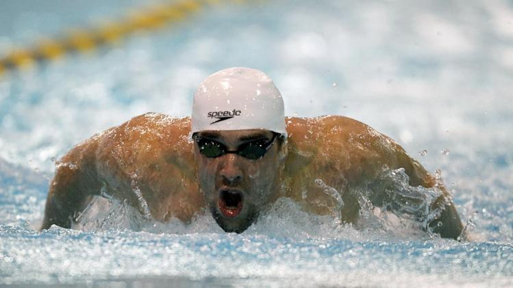 Michael Phelps muscles through the water as he competes in the Men's 200 Meter Butterfly preliminaries at the 2012 Charlotte UltraSwim Grand Prix in Charlotte, N.C., Saturday, May 12, 2012. Michael Phelps finished second in his heat. (AP Photo/Bob Leverone)