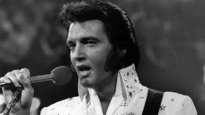 FILE - In this undated file photo released by NBC-TV, singer Elvis Presley is shown in concert in the later part of his career.  Presley's estate announced it has authorized holograms of the King of Rock, Marilyn Monroe's estate has expressed interest and there's no shortage of other beloved stars whose fans would die to see them perform again.  (AP Photo/NBC-TV, FILE)